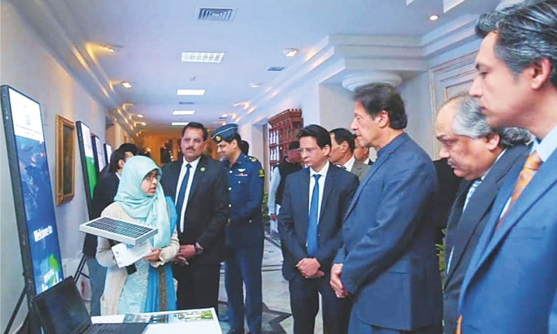 ISLAMABAD: Prime Minister Imran Khan visits stalls during a ceremony at the National Incubation Centre for startups on Wednesday. The prime minister assured young entrepreneurs of the government's assistance in transforming their innovative ideas into sustainable businesses.—INP