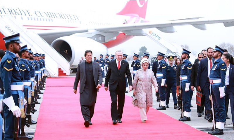 PM Imran Khan walks alongside Turkish President Recep Tayyip Erdogan and his wife Emine Erdoğan at Nur Khan Airbase. — Courtesy PM Office