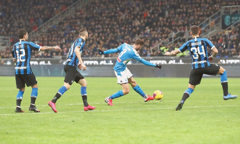 MILAN: Napoli's Fabian Ruiz (second R) scores during the Coppa Italia match against Inter Milan at San Siro.—AP