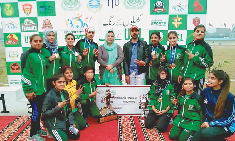 LAHORE: Athletes who excelled in the recently held University Sports League Athletics Championship here pose with their medals and prize cheque.