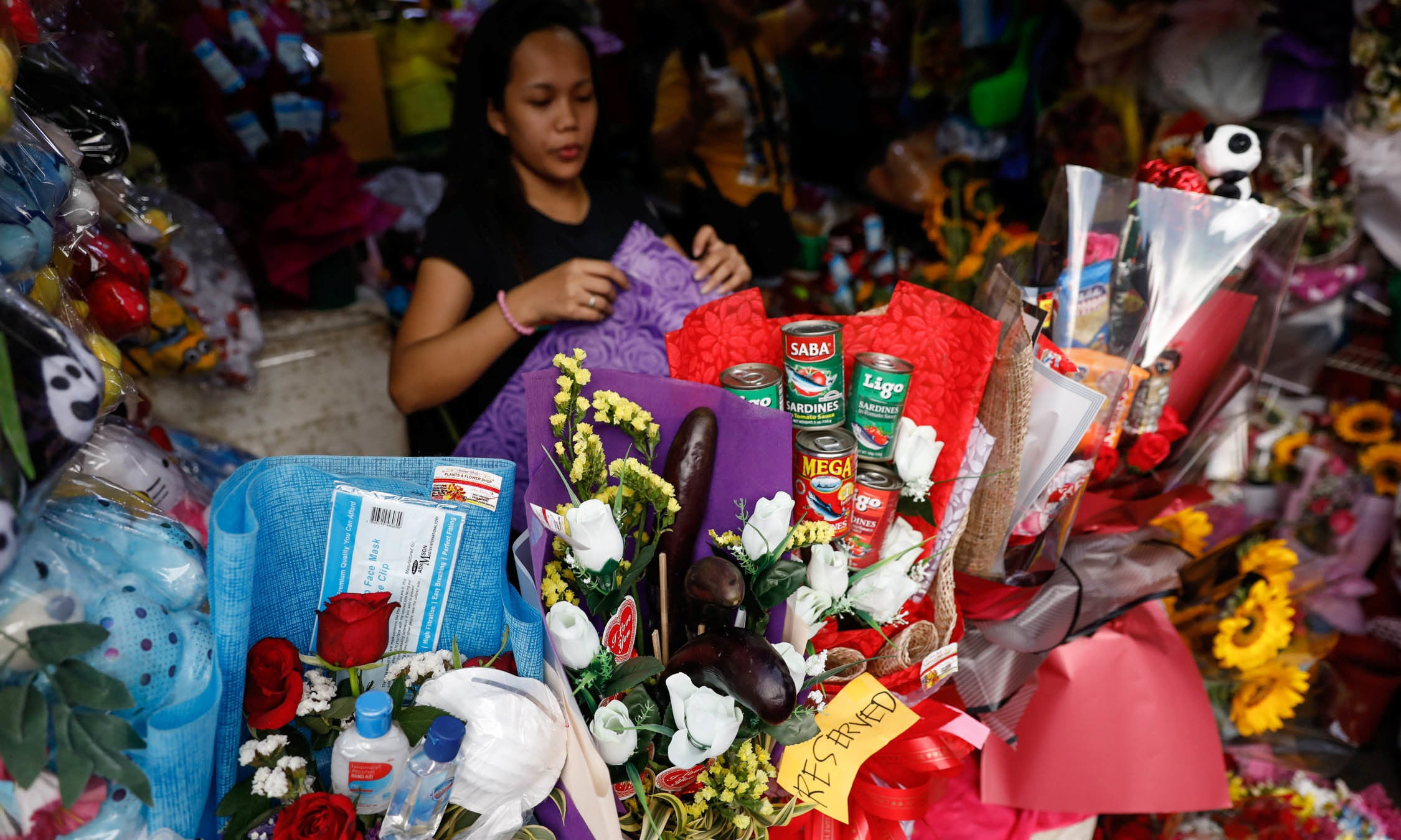 Special bouquets of flowers, including one with bottles of alcohol and an N95 mask, are sold in a flower market following confirmed cases of coronavirus in the country, a day before Valentines Day in Manila, Philippines on February 13. — Reuters