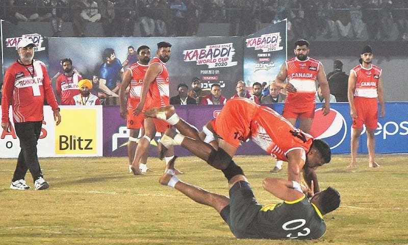 Pakistani and Canadian kabaddi players in action during a match of the Kabbadi World Cup 2020 in at Punjab Stadium, Lahore. Pakistan won its last pool match on Friday. — M. Arif/White Star