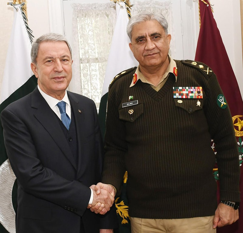 Gen (retired) Hulusi Akar and Army Chief Gen Qamar Javed Bajwa shake hands. — Photo: ISPR