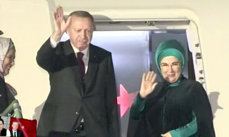 President Erdogan and First Lady Emine Erdogan wave as they depart from Pakistan. — DawnNewsTV