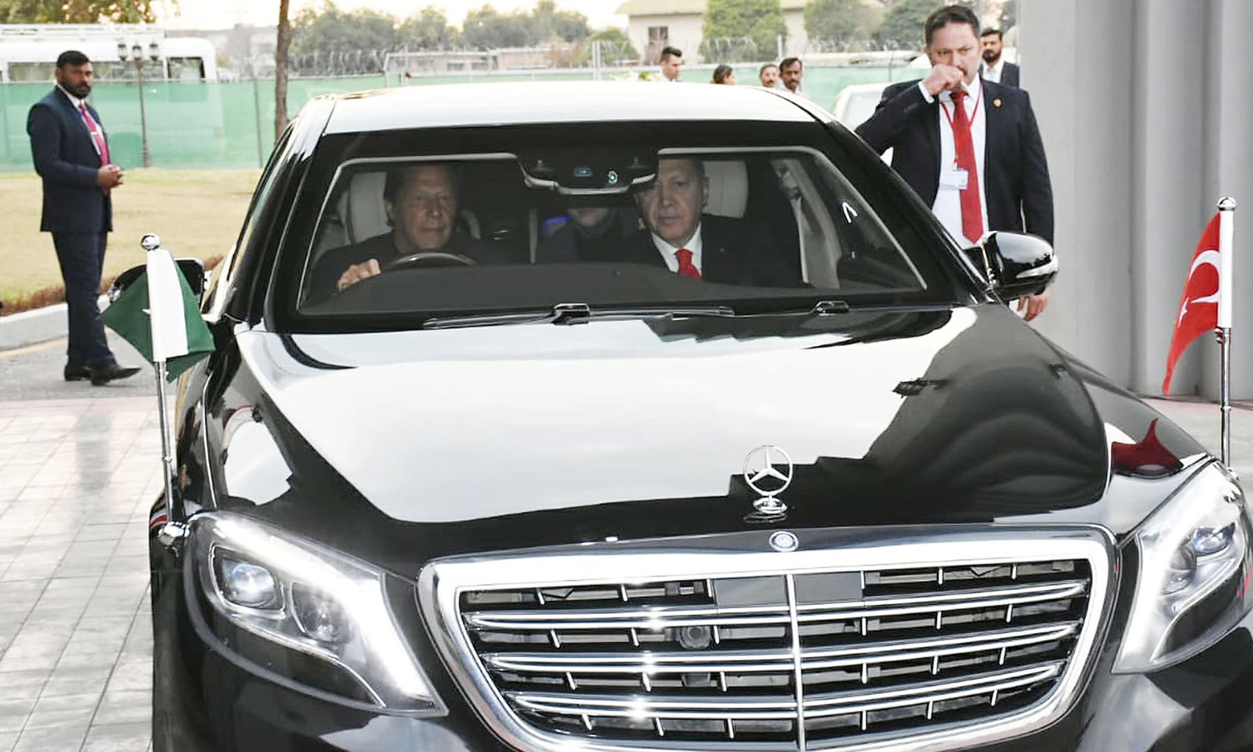 In this photo released by the Press Information Department, PM Imran Khan, left, drives visiting Turkey's President Recep Tayyip Erdogan from Nur Khan Airbase to Prime Minister House in Islamabad. — AP