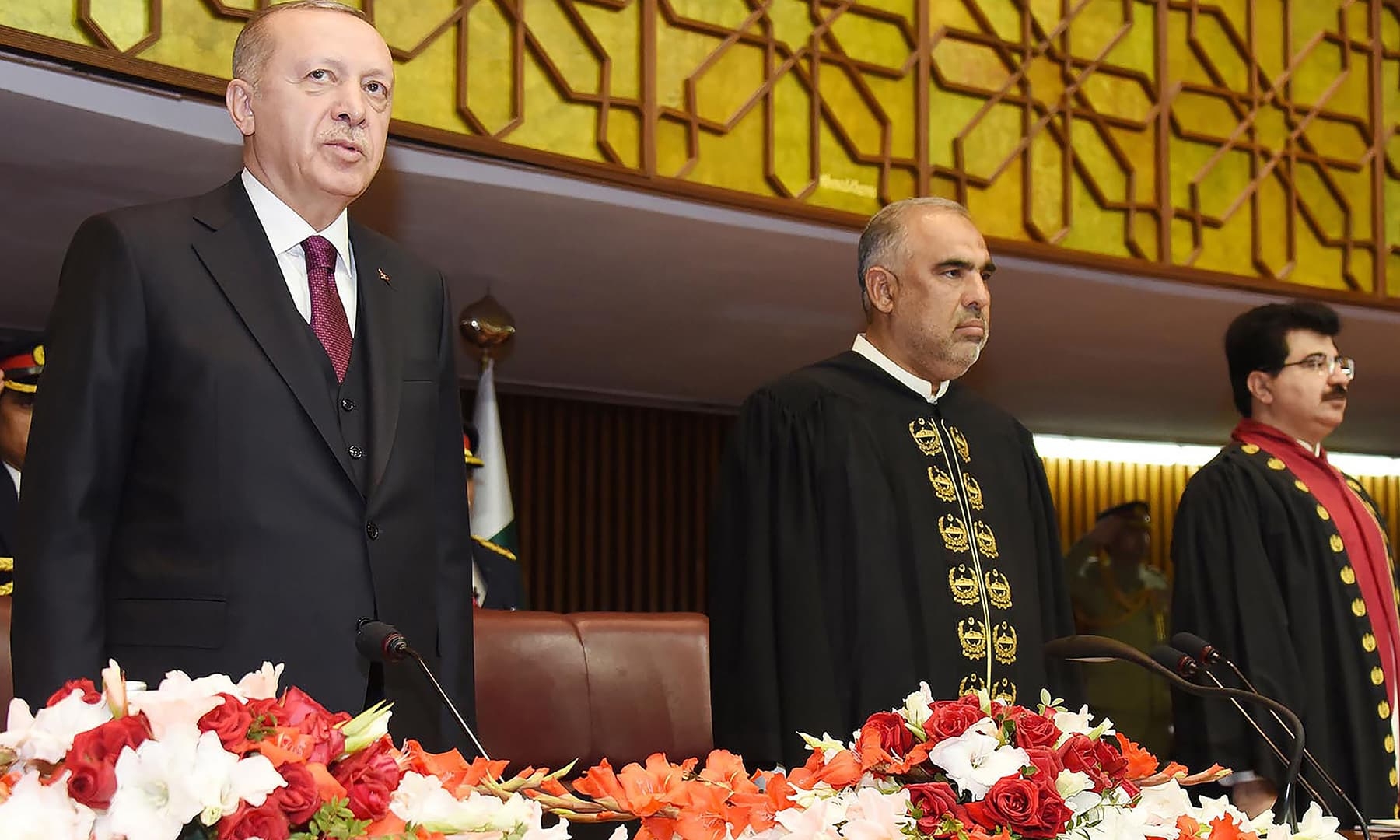 Turkish President Erdogan (L) stands with Asad Qaiser, speaker of the National Assembly, before addressing the joint session of Parliament. — AFP/PID