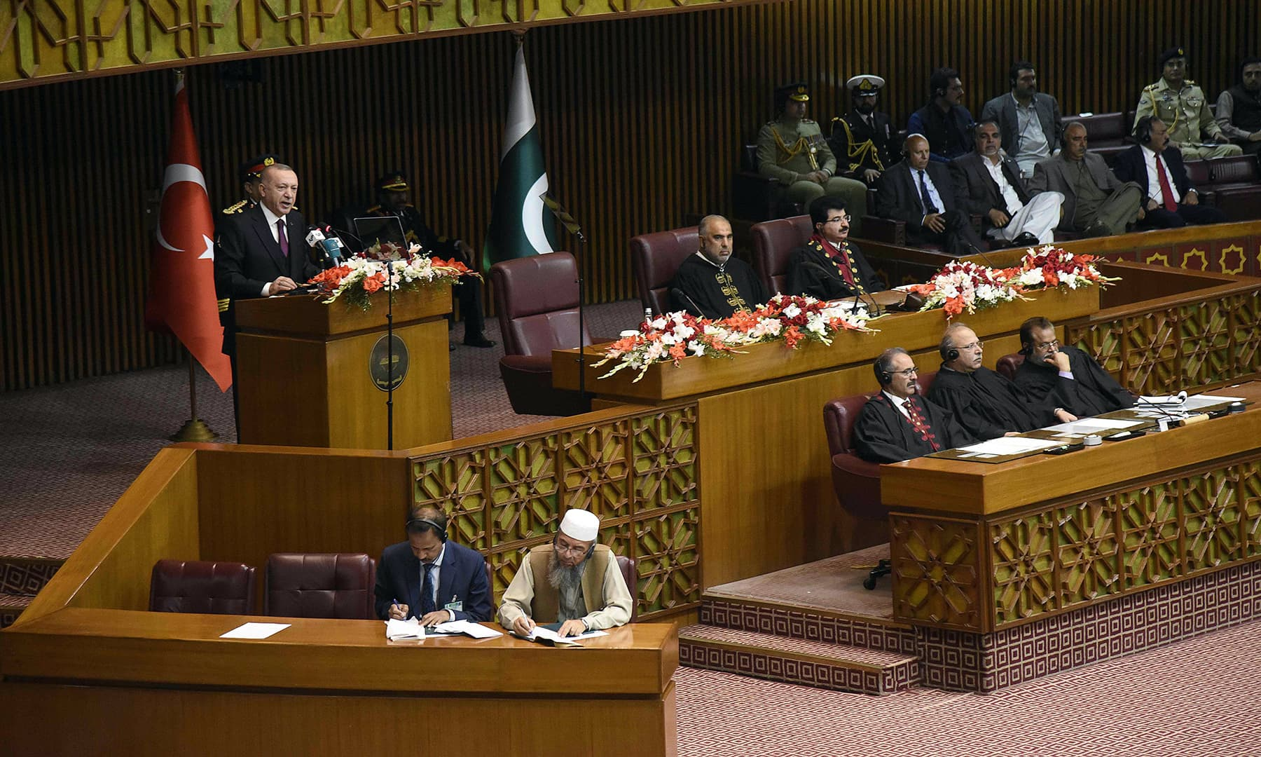 Turkish President Erdogan (top L) addresses the joint session of Parliament in Islamabad on February 14. — AFP