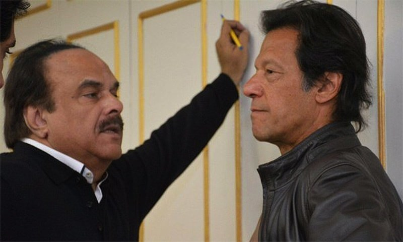 PTI's late leader Naeemul Haque pictured with Prime Minister Imran Khan. — File photo