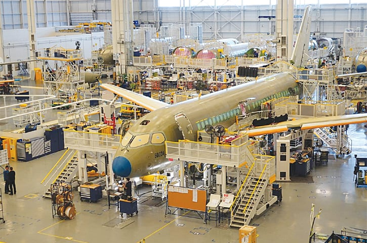 An Airbus A220 passenger jet stands in the final assembly line in Mirabel near Montreal, Quebec, Canada on January 14, 2019.—Reuters