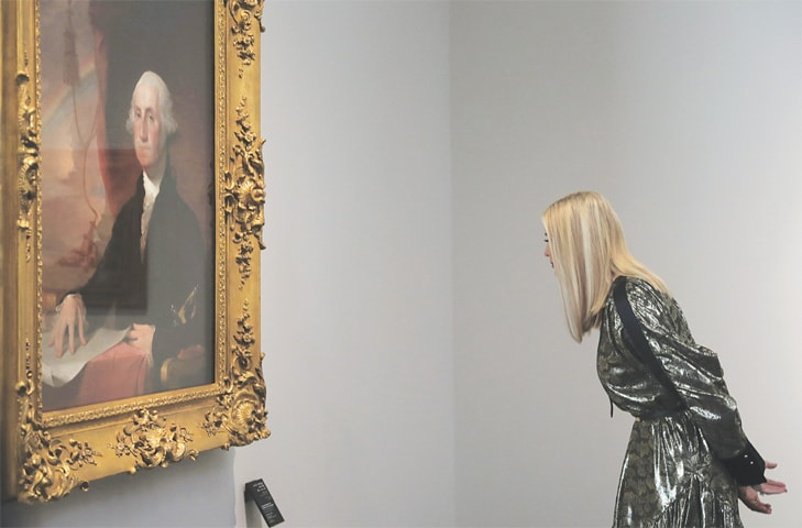 Ivanka Trump, the senior adviser to President Donald Trump, looks at the portrait of George Washington painting at the Louvre Museum in Abu Dhabi on Saturday.—AP