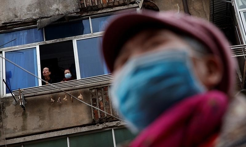 People wear protective masks in an old neighbourhood of Jiujiang, Jiangxi province, China, as the country is hit by an outbreak of novel coronavirus, on February 2. — Reuters/File