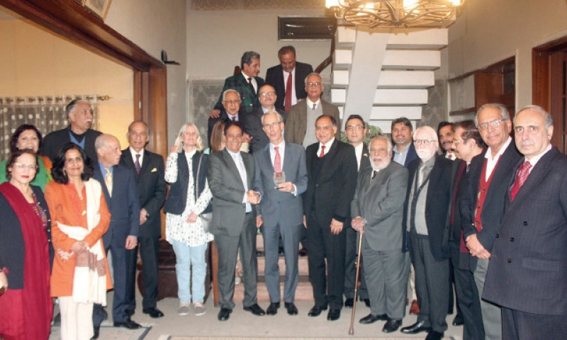 Ambassador of the Netherlands Wouter Plomp being presented a shield by English Speaking Union Islamabad President Khalid Malik. Diplomats from various countries are also present.