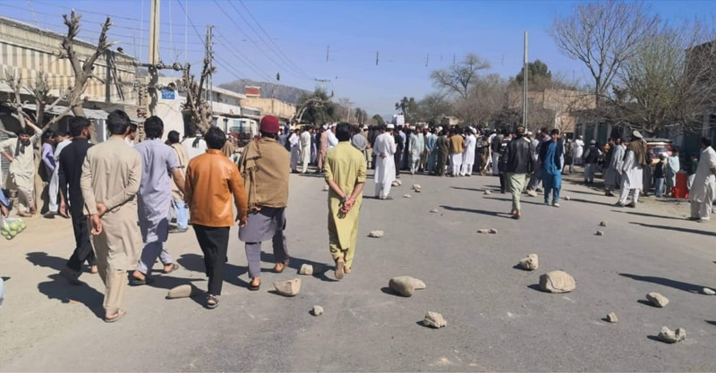Hangu: People march on a road on Sunday in protest against sexual assault and murder of a girl.—Dawn