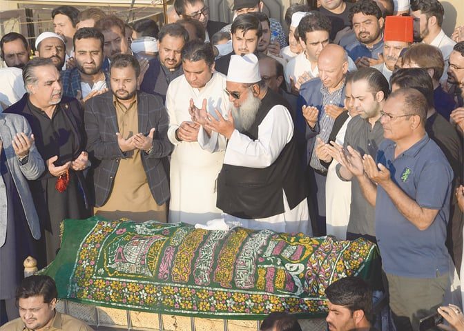 Funeral prayers for Naeem-ul-Haq are being offered at a mosque in Defence Housing Authority on Sunday.—White Star