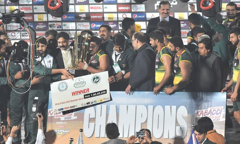 PAKISTAN players receive the trophy at the end of the final.—White Star