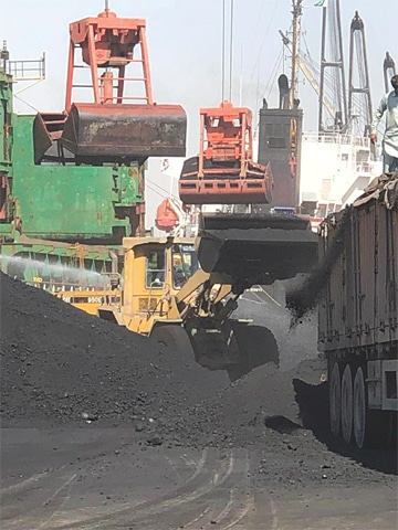 Pet coke is being handled at the Karachi Port Trust in this image provided by Sepa.