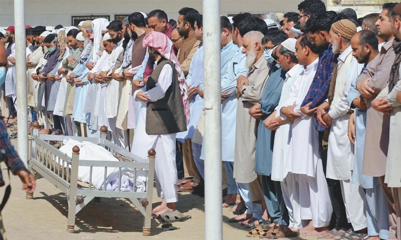 Funeral prayers being offered for one of the victims on Monday in this PPI picture.