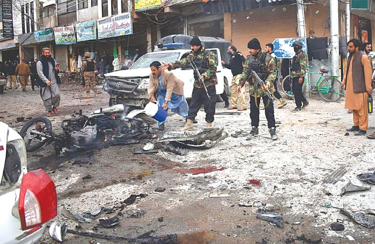 QUETTA: Security personnel at the blast site near the press club on Monday.—INP