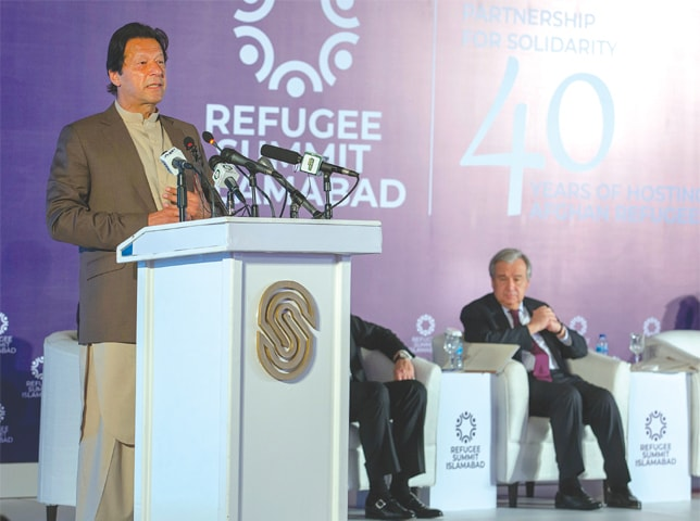 ISLAMABAD: Prime Minister Imran Khan addresses the refugees conference on Monday as UN secretary general Antonio Guterres looks on.—Tanveer Shahzad / White Star