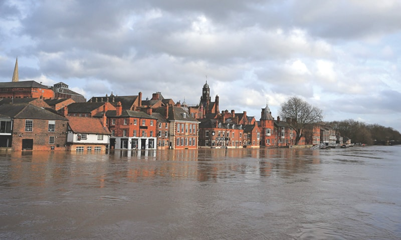 York (UK): Floodwater rises up buildings alongside the River Ouse  after it burst its banks on Monday in the aftermath  of Storm Dennis.—AFP
