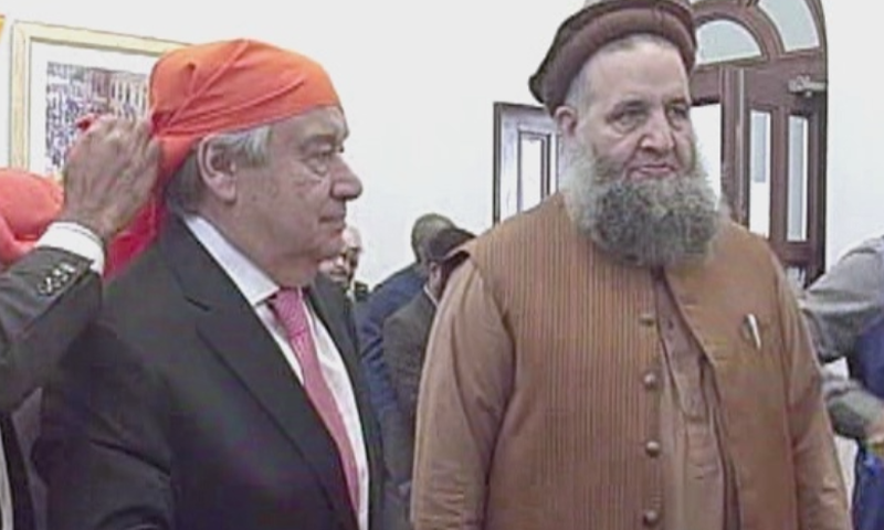 A traditional orange kerchief being tied on the UN secretary general's head before he went to visit the newly-renovated gurdwara.  — DawnNewsTV