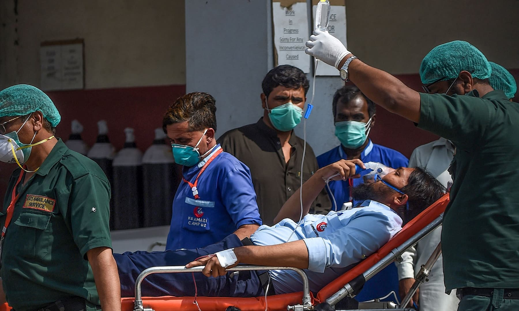 Paramedics personnel shift a patient on a stretcher into the hospital in Karachi on February 18, after the gas leak. — AFP