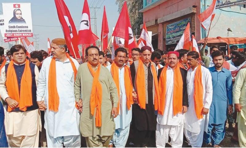 ACTIVISTS of Hindu organisations, Rawadari Tehreek and civil society organisations hold a rally in Jacobabad.