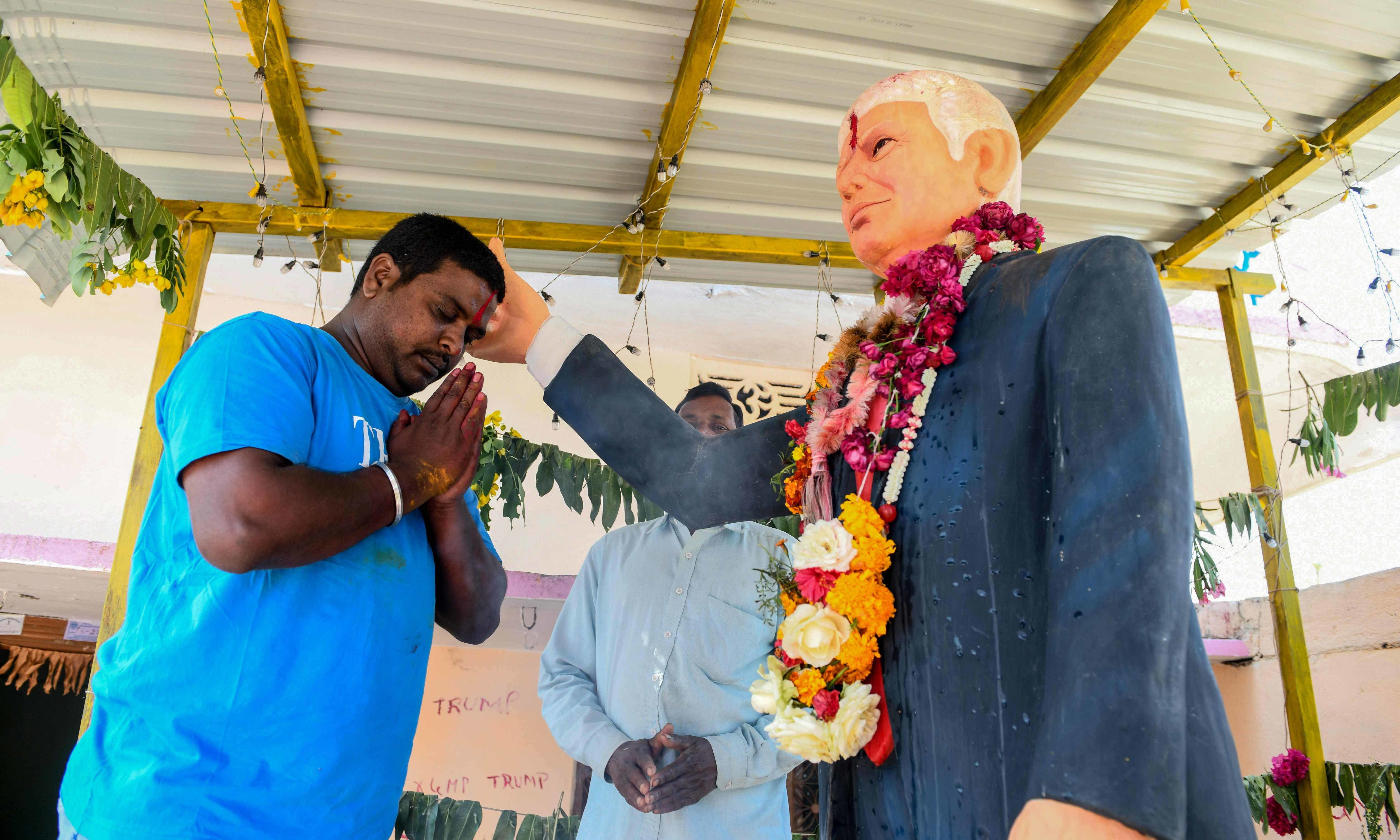 Die-hard Donald Trump fan Bussa Krishna is celebrating the visit of his hero to India next week the only way he knows how — offering prayers to a life-sized idol of the US president in his home. — AFP