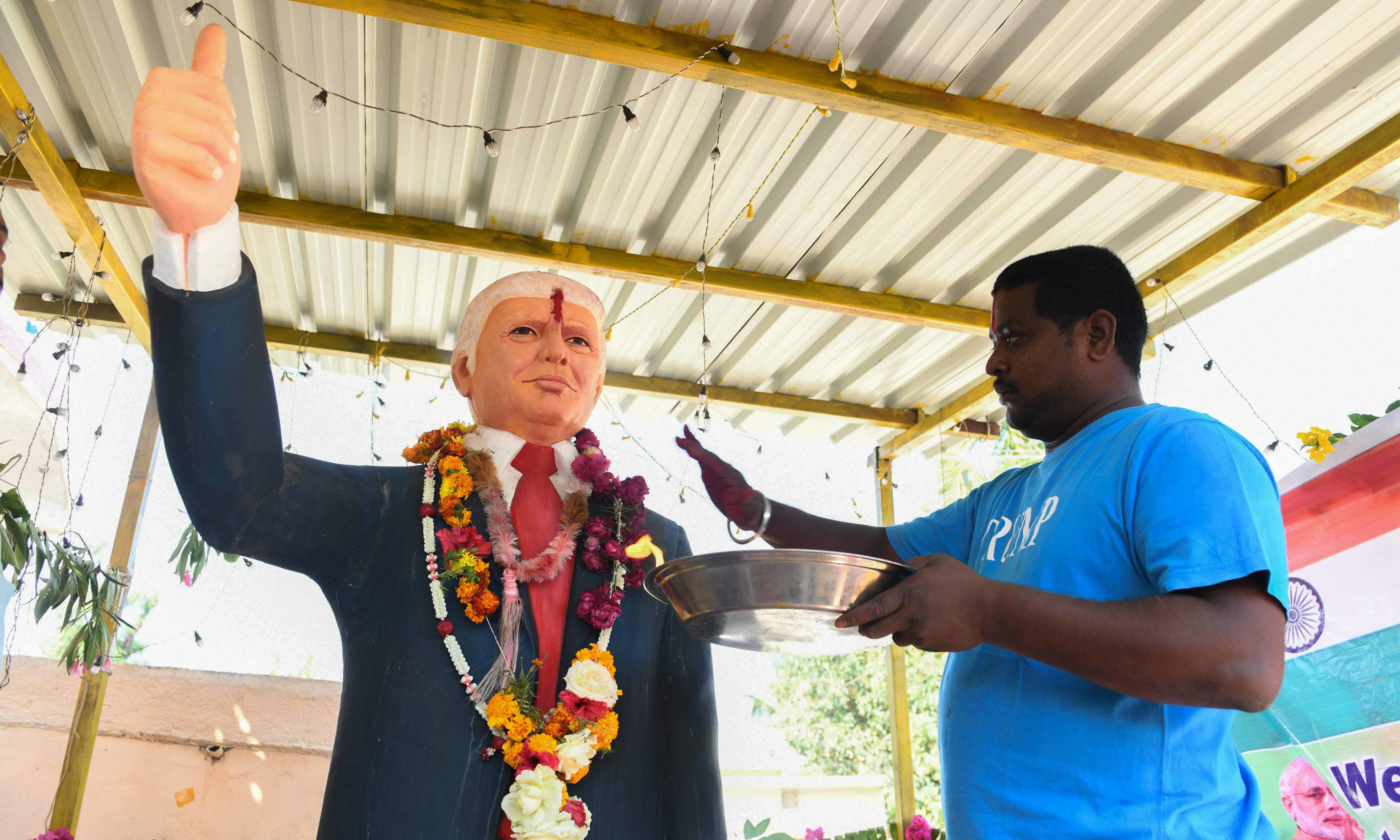 In this photo taken on February 17, farmer Bussa Krishna, 33, offers special prayers to the statue of US President Donald Trump, at his residence in Jangaon district in Telangana state, some 120 km from Hyderabad, ahead of the visit of US President Donald Trump to India. — AFP