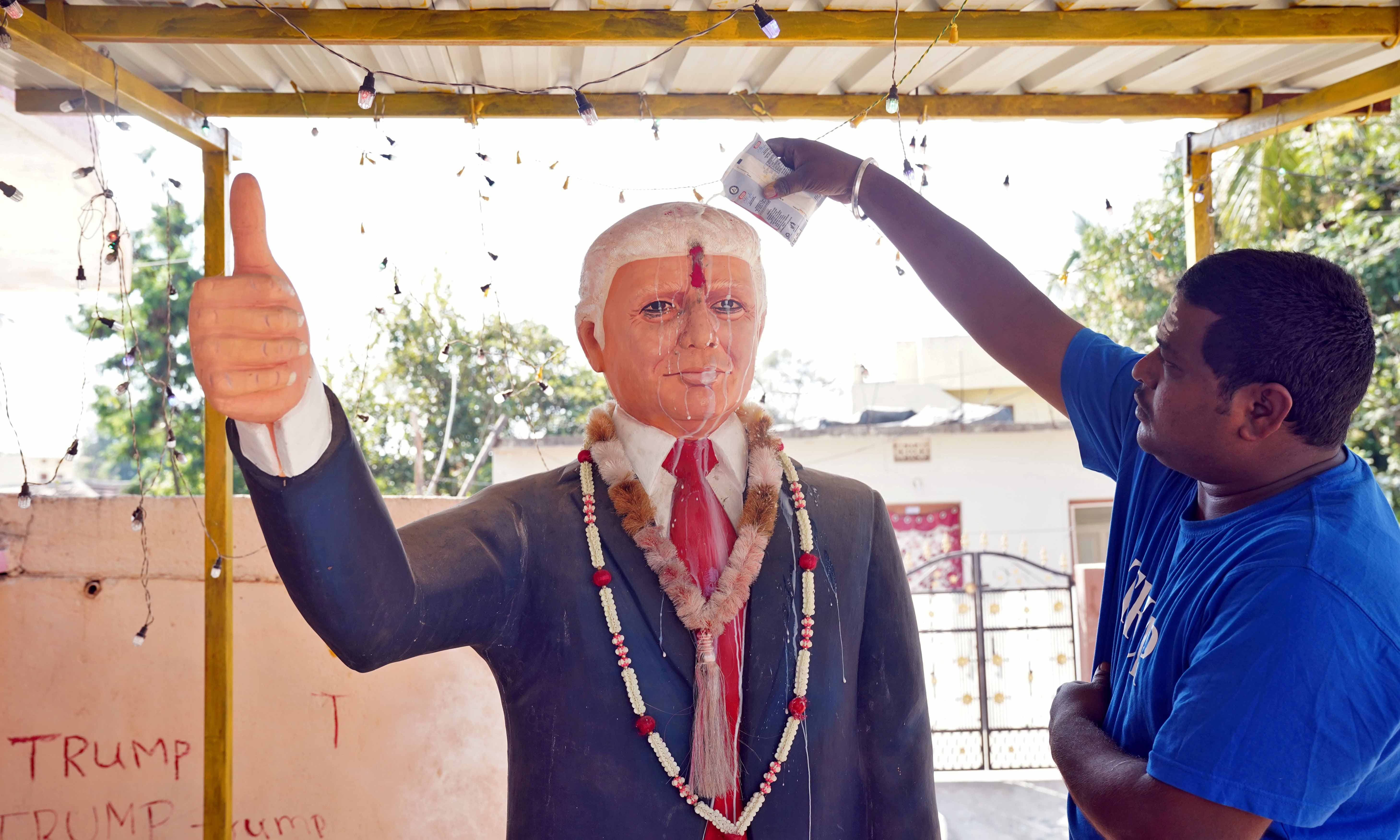 Bussa Krishna, a fan of US President Donald Trump, offers prayers to a statue of Trump at his house in Konney village in the southern state of Telangana, India on February 14. — Reuters