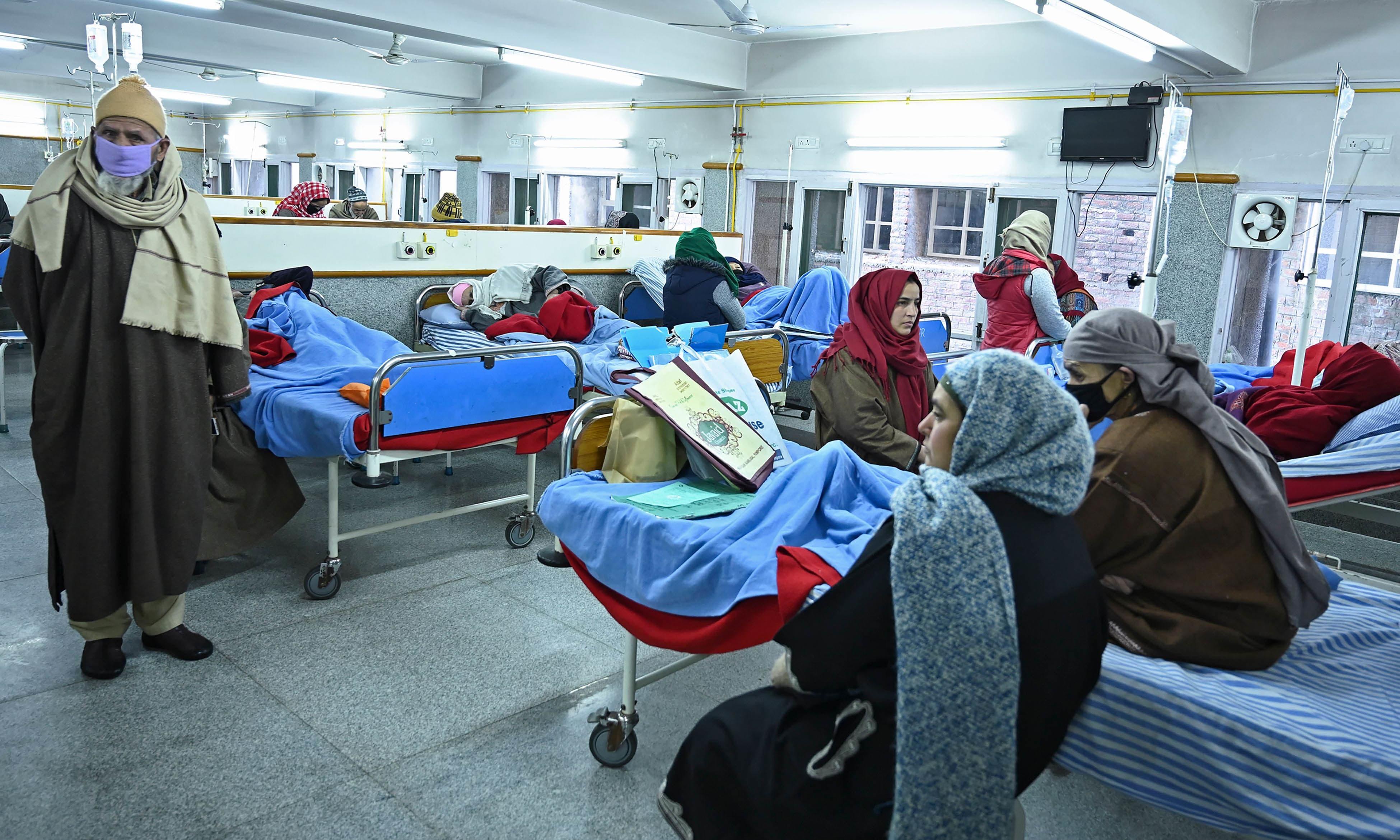 Cancer patients rest inside a hospital ward in Srinagar. — AFP