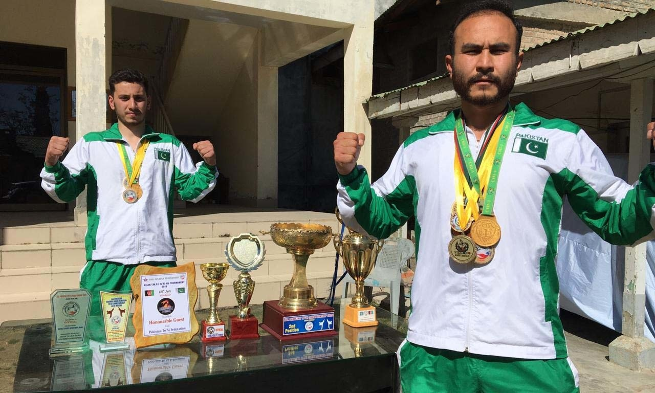 Facing high costs of competing in professional sports, gold medallist martial artists appeal to government for support. — Photo provided by author.