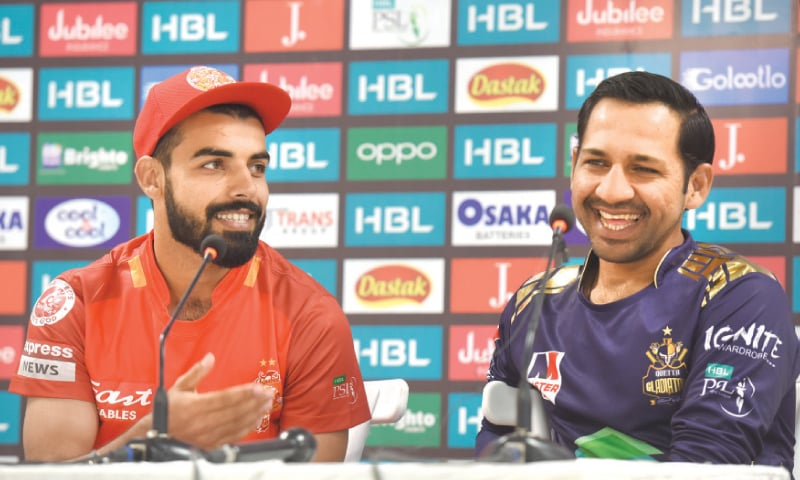 ISLAMABAD United captain Shadab Khan (L) and his Quetta Gladiators counterpart Sarfraz Ahmed gesture during a news conference on Wednesday.—White Star