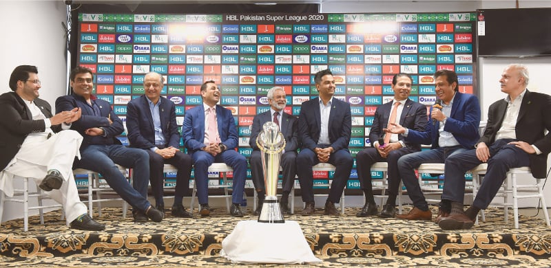 KARACHI: PCB chairman Ehsan Mani, CEO Wasim Khan and PSL franchise owners share a light moment during the news conference on Wednesday.—Tahir Jamal/White Star