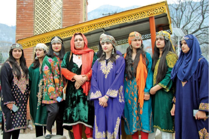 The AJK University students wearing pheran and jewellery. — Photos by the writer