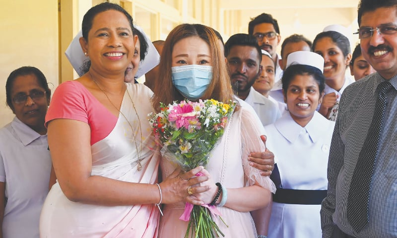 Colombo: A Chinese tourist (centre), who tested positive for the coronavirus and was isolated for treatment, poses for photographs with Sri Lankan Health Minister Pavithra Wanniarachchi (front left) and medical staff after she was discharged from the main infectious diseases hospital on Wednesday following her recovery. The 43-year-old woman, the first and only Covid-19 patient in Sri Lanka, was admitted to the hospital on Jan 25 and tested positive two days later.—AFP