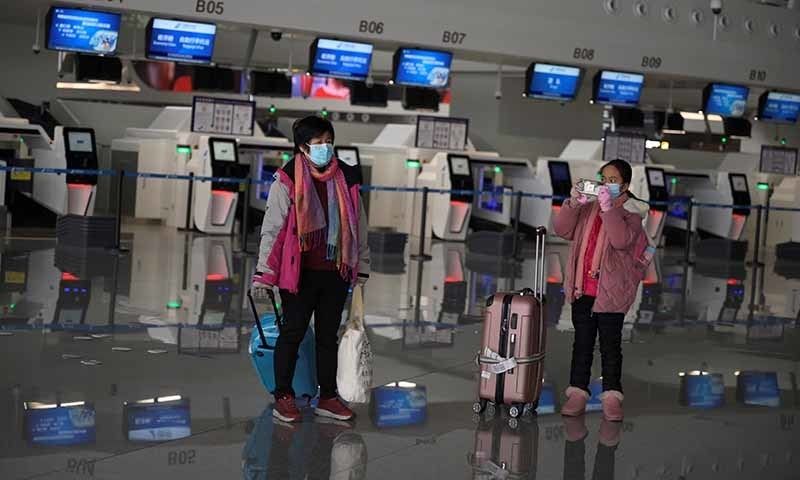 Passengers wearing face masks are seen with their suitcases at the Beijing Daxing International Airport, as the country is hit by an outbreak of the novel coronavirus, in Beijing, China on February 20. — Reuters