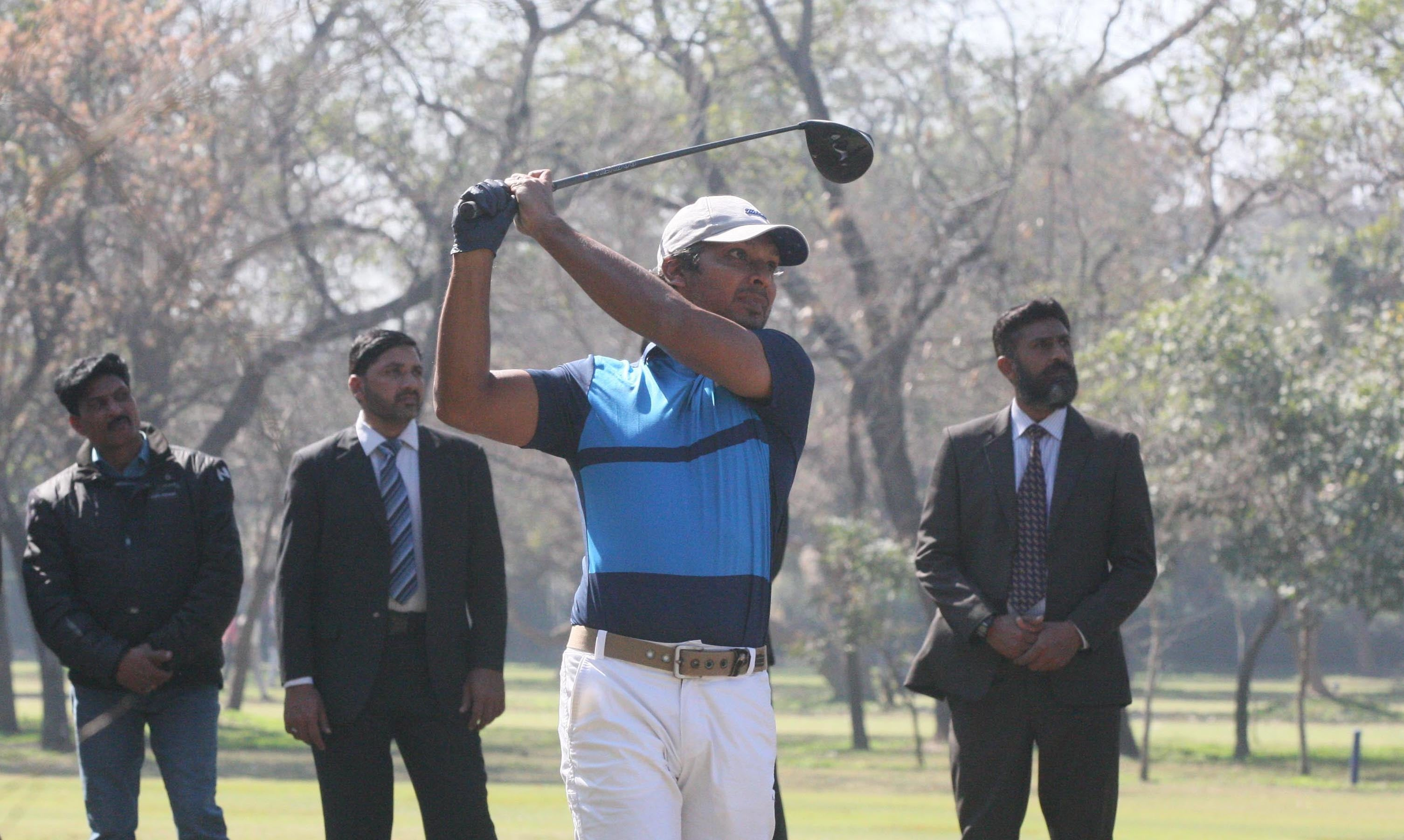 "The team captain Kumar Sangakkara playing golf at the Lahore Gymkhana golf course where he said the team was hosted with ""amazing hospitality and warmth"".  — Photo courtesy PCB"