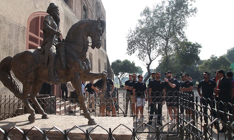 The international players admire a statue of Ranjit Singh at the Lahore Fort. — Photo courtesy PCB