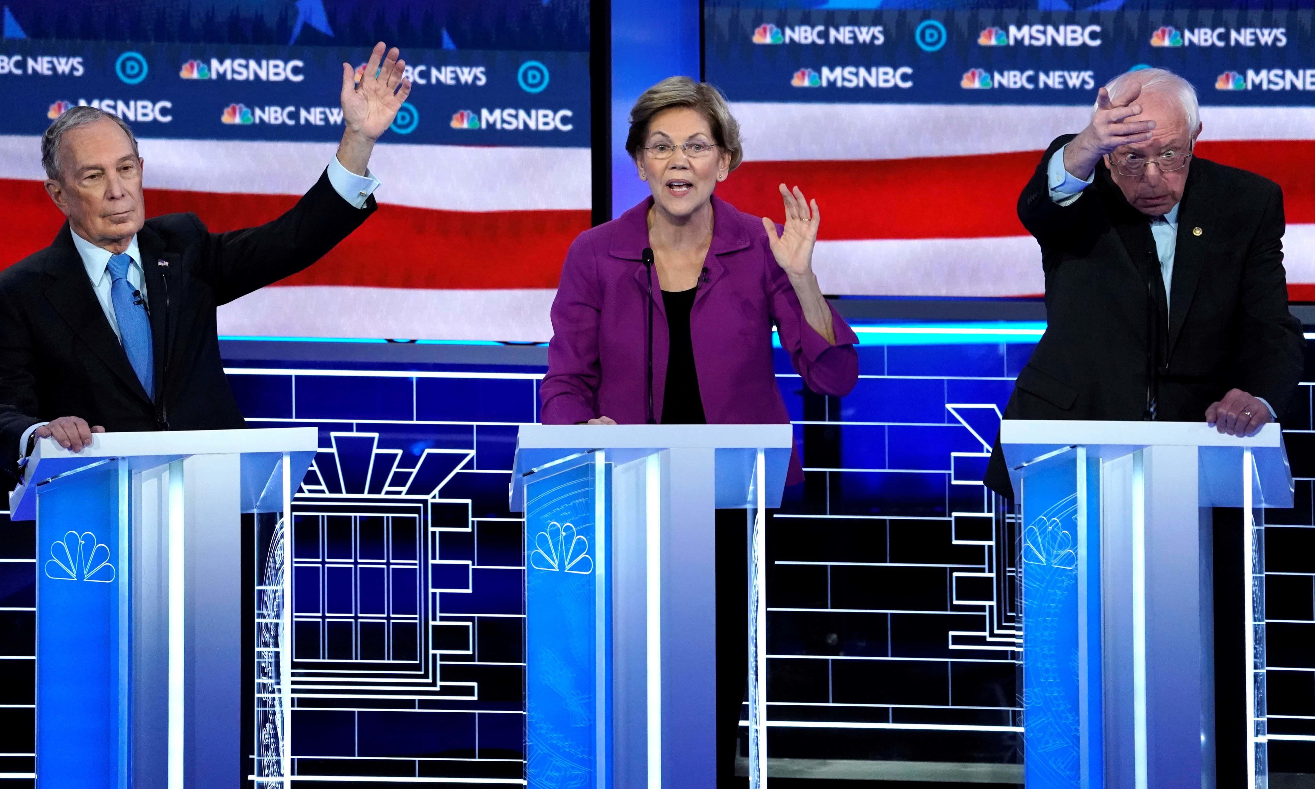 Senator Elizabeth Warren speaks as former New York City mayor Mike Bloomberg and Senator Bernie Sanders try to get the moderators' attention at the Democratic presidential debate on Feb 20. — Reuters