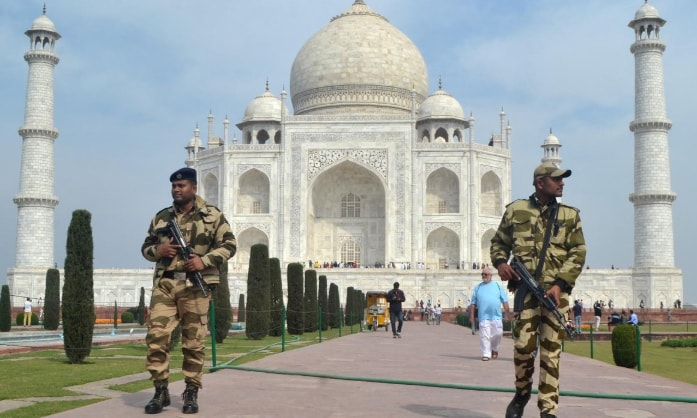 Central Industrial Security Force (CISF) personnel patrol at the historic Taj Mahal premises, where US President Donald Trump and first lady Melania Trump are expected to visit, on Feb 20. — Reuters