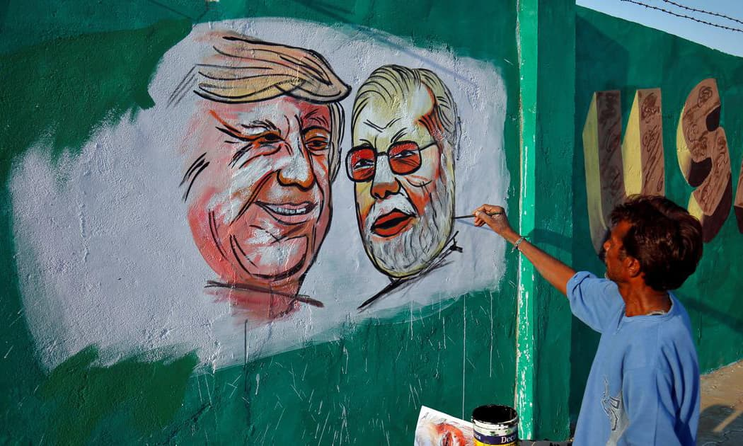 Paintings of US President Donald Trump and Indian Prime Minister Narendra Modi on a wall as part of a beautification project ahead of Trump's upcoming visit to Ahemdabad. —Reuters