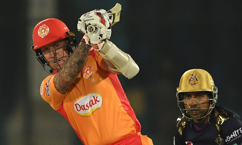 Luke Ronchi (L) of Islamabad United plays a shot as Quetta Gladiators wicketkeeper Sarfraz Ahmed (R) looks on during the first PSL 2020 cricket match at the National Cricket Stadium in Karachi on February 20. — AFP