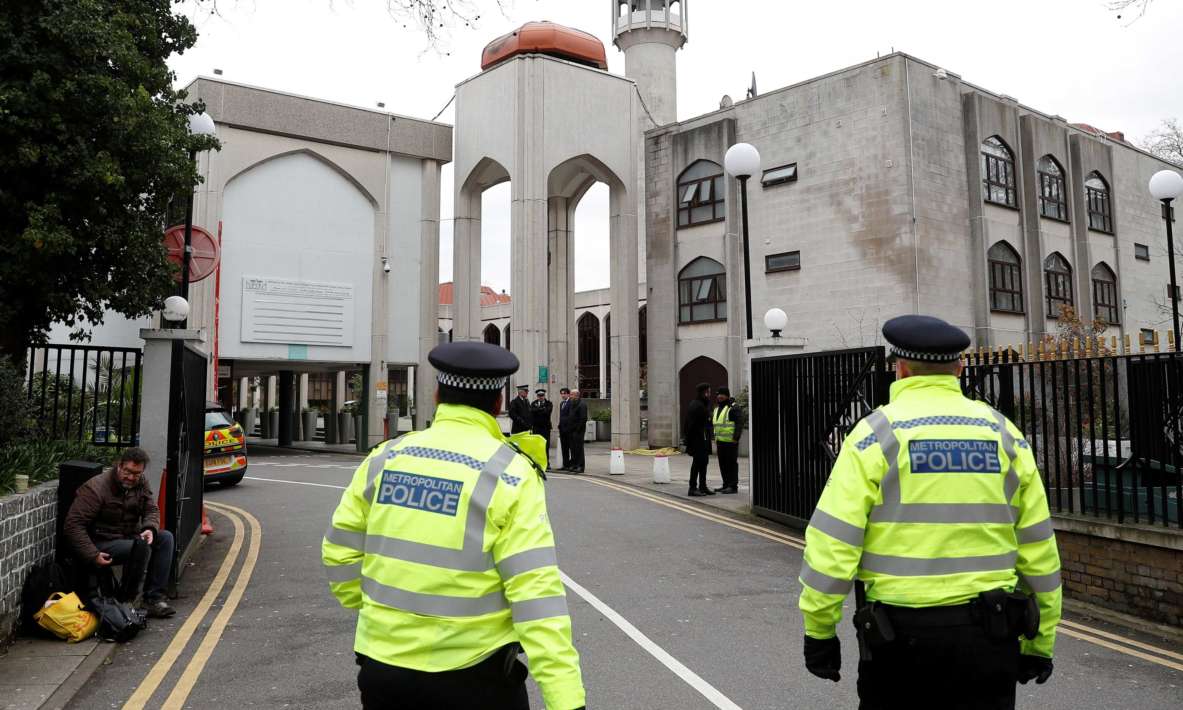 Police officers stand outside the London Central Mosque on Feb 21. — Reuters