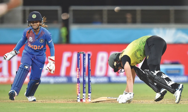 AUSTRALIA'S Ellyse Perry (R) is dismissed by India's Poonam Yadav during the opening match of the women's Twenty20 World Cup on Friday.—AFP