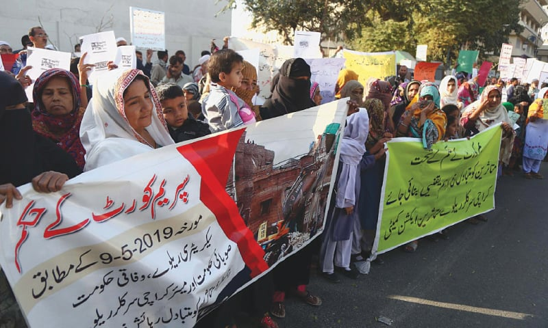 Members of Karachi Circular Railways Victims Action Committee protest against the anti-encroachment drive outside the Supreme Court registry.—PPI
