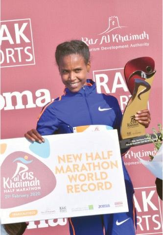 ABABEL Yeshaneh poses on the podium after winning RAK Half Marathon.—AFP