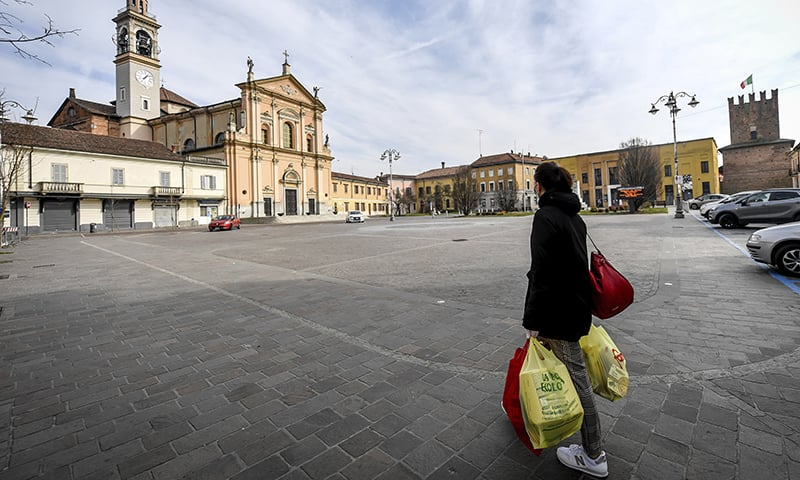 A woman carries shopping bags in Casalpusterlengo, Northern Italy, Sunday, February 23, 2020. — AP