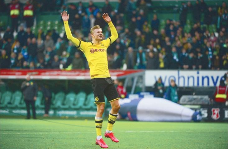 BREMEN: Borussia Dortmund's Erling Braut Haaland gestures during the Bundesliga match against Werder Bremen.—AFP