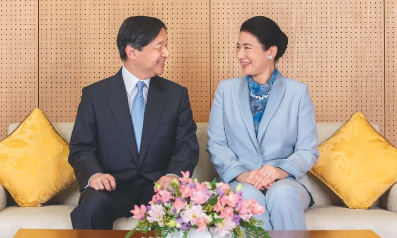 Tokyo: Emperor Naruhito and Empress Masako pose for a photo at their residence ahead of the emperor's 60th birthday.—Reuters